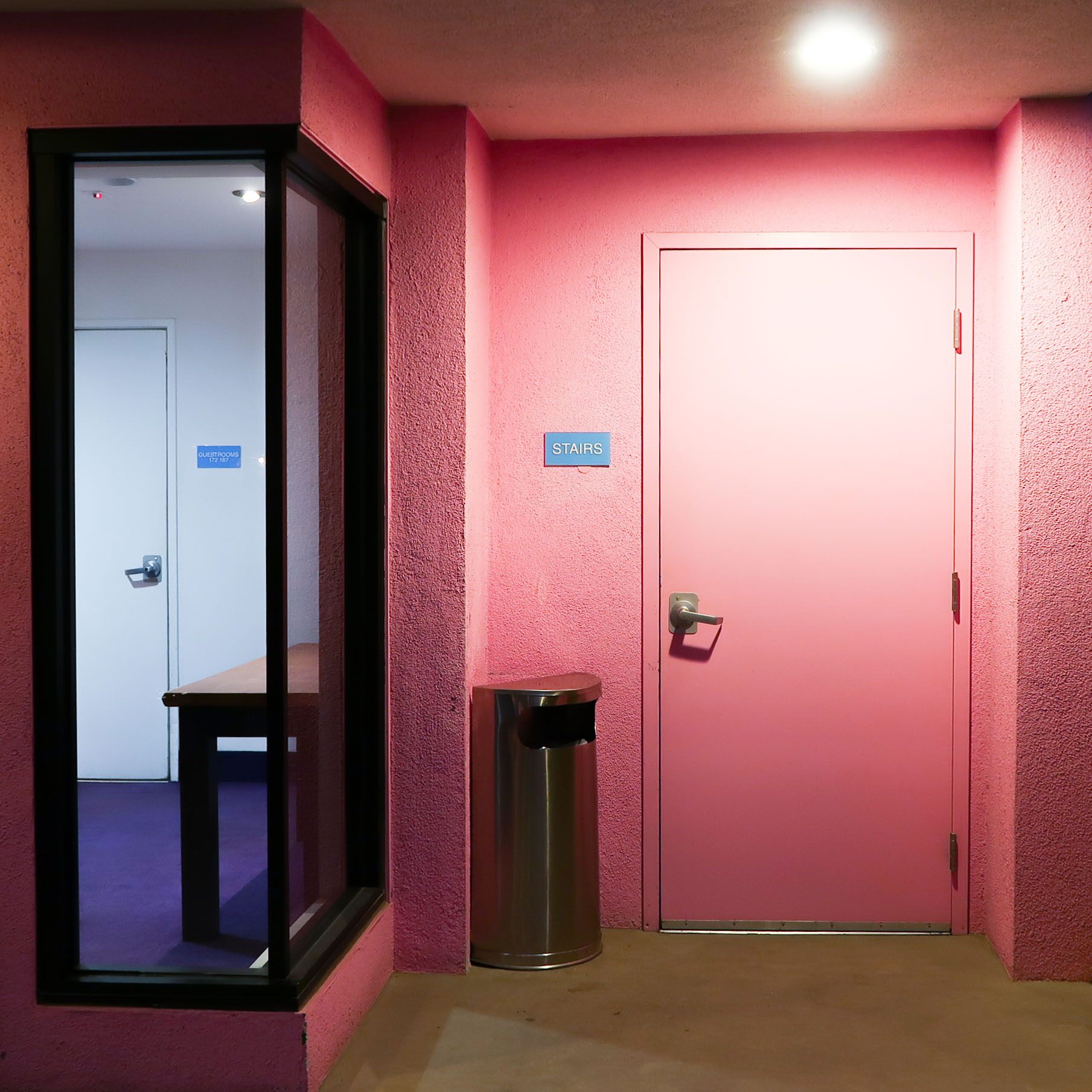 Pink door - night time at The Saguaro Palm Springs